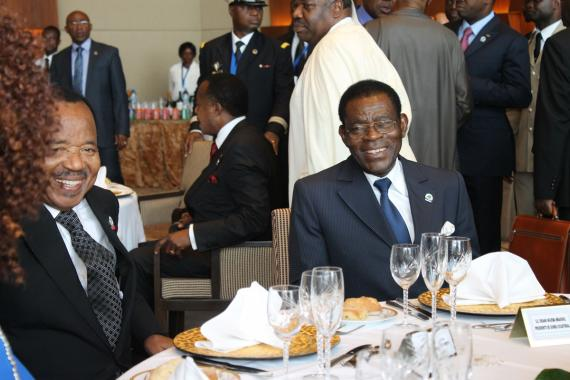 President Teodoro Mbasogo of Equatorial Guinea laughs over lunch alongside President Paul Biya of Cameroon