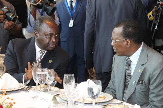 President of the Central African republic Francois Bozine (left) in talks with fellow leaders at the Presidential luncheon