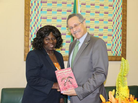 Ghana's former Ambassador to the European Union Amb. Nana Bema Kumi gives a copy of her memoirs to ACP Secretary General Gomes.