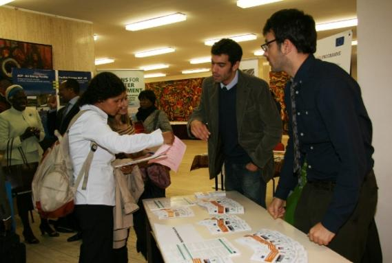Antonio Stinelli and Robert Bach Casanovas of the ACP MTS Programme distribute information to visitors.