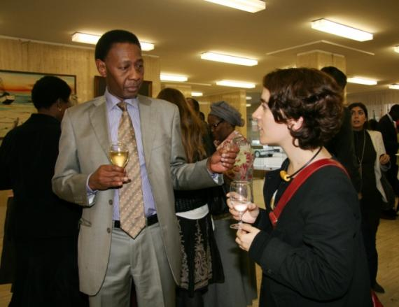 ACP Development Finance expert Dr Magatte Coulibaly in talks with guest at the Open Day reception event