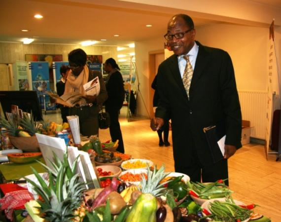 ACP Secretary General Dr Mohamed Ibn Chambas surveys booths at the SEDT Open Day.