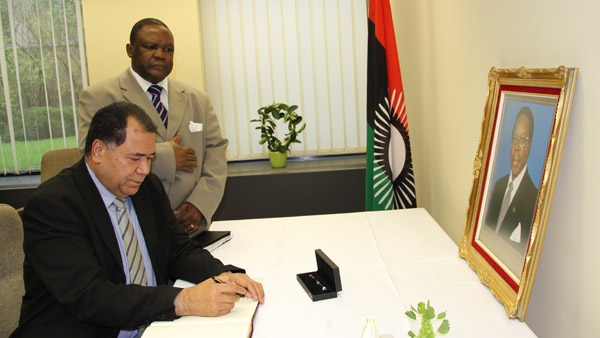 Acting ACP Secretary General Paulo Katuoke and Chef de Cabinet Dr Obadiah Mailafia sign condolence book at the Malawi Embassy