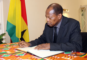 ACP Secretary General Dr Mohamed Ibn Chambas signs condolence book for late President John Atta Mills in Brussels.